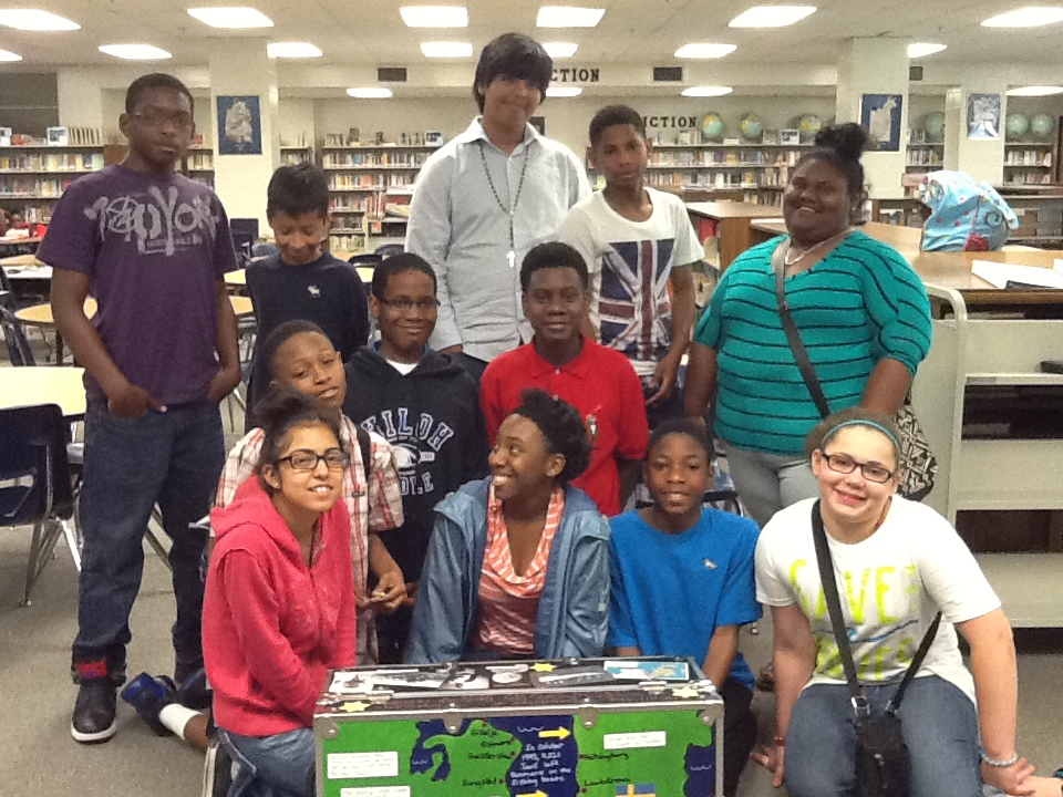 Students of Shiloh Middle School in Gwinnett County pose with a trunk.