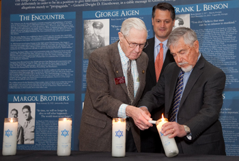 Representative John Yates lights a candle with Holocaust survivor Ben Walker at the 2015 Days of Remembrance